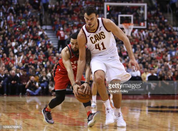 Fred Van Vleet of the Toronto Raptors fights for the ball with Ante Zizic of the Cleveland Cavaliers during the second half of the NBA season opener...