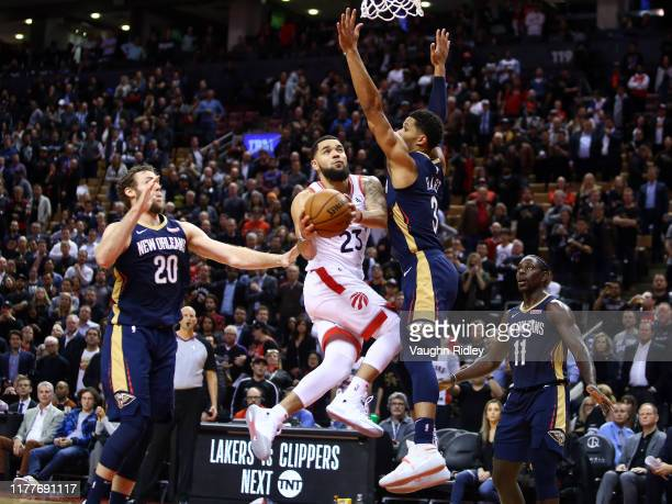 Fred Van Vleet of the Toronto Raptors shoots the ball as Josh Hart of the New Orleans Pelicans defends during the second half of an NBA game at...