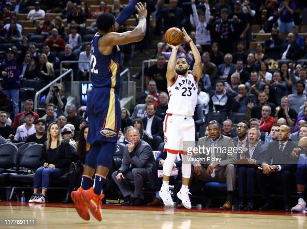 Fred Van Vleet of the Toronto Raptors sinks a late 3 pointer as Derrick Favors of the New Orleans Pelicans defends during the second half of an NBA...