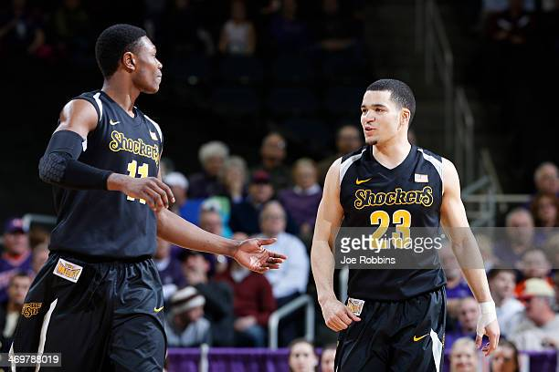 Fred VanVleet and Cleanthony Early celebrate during the game against the Evansville Purple Aces at Ford Center on February 16 2014 in Evansville...