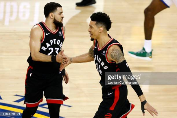 Fred VanVleet and Danny Green of the Toronto Raptors celebrate the play against the Golden State Warriors in the second half during Game Three of the...