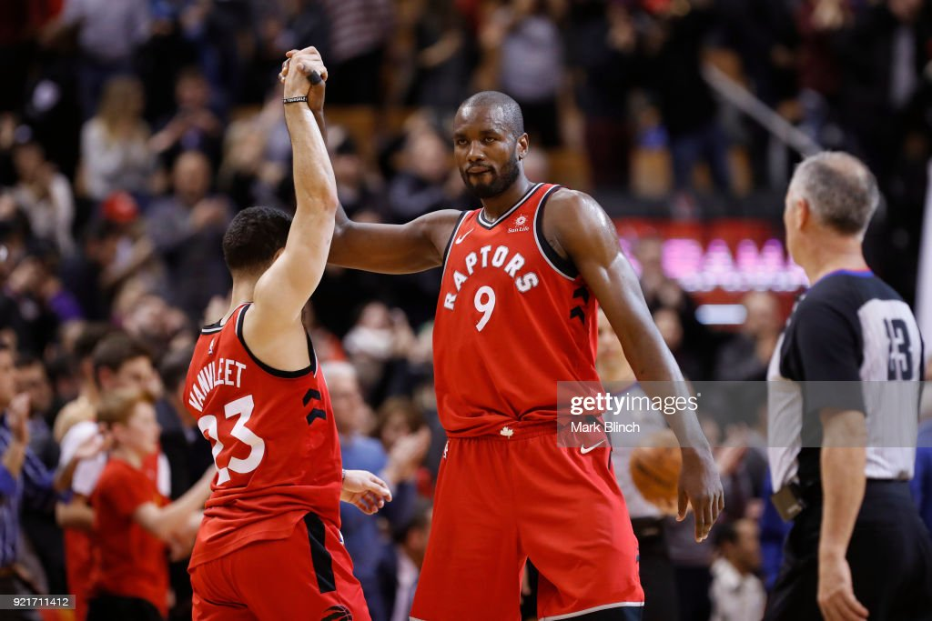 Fred VanVleet #23 and Serge Ibaka #9 of the Toronto Raptors high five during the game against the Minnesota Timberwolves on January 30, 2018 at the Air Canada Centre in Toronto, Ontario, Canada.