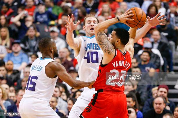TORONTO ON MARCH 4 Fred VanVleet of the Raptors is double teamed by Kemba Walker and Cody Zeller of the Hornets during the 2nd half of NBA action as...