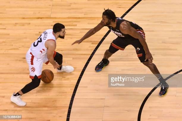 Fred VanVleet of the Toronto Raptors against Justise Winslow of the Miami Heat during the Toronto Raptors vs Miami Heat NBA regular season game at...