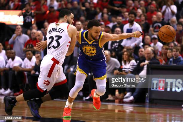 Fred VanVleet of the Toronto Raptors and Stephen Curry of the Golden State Warriors battle for the ball in the second half during Game Two of the...