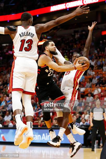 Fred VanVleet of the Toronto Raptors attempts a layup against Bam Adebayo and Kendrick Nunn of the Miami Heat during the first half at American...