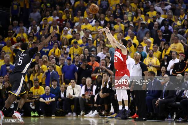 Fred VanVleet of the Toronto Raptors attempts a shot against Kevon Looney of the Golden State Warriors in the first half during Game Six of the 2019...
