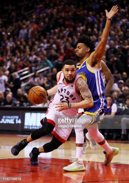 Fred VanVleet of the Toronto Raptors attempts a shot against Quinn Cook of the Golden State Warriors in the second half during Game One of the 2019...