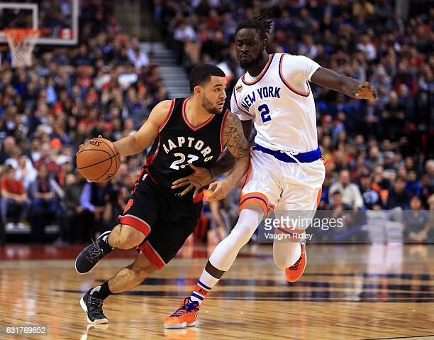 Fred VanVleet of the Toronto Raptors dribbles the ball as Maurice Ndour of the New York Knicks defends during the second half of an NBA game at Air...