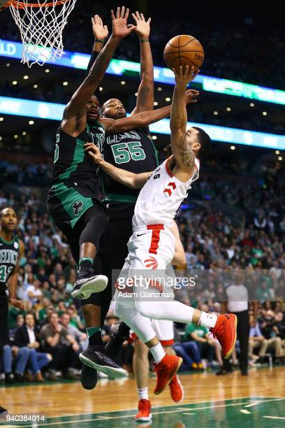 Fred VanVleet of the Toronto Raptors drives to the basket while guarded by Kadeem Allen and Greg Monroe of the Boston Celtics during a game at TD...