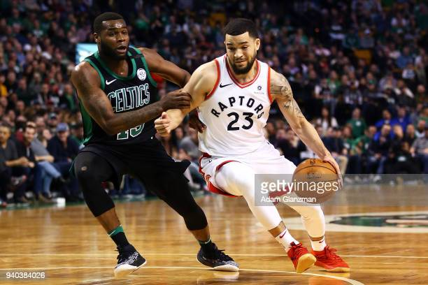 Fred VanVleet of the Toronto Raptors drives to the basket while guarded by Kadeem Allen of the Boston Celtics during a game at TD Garden on March 31...