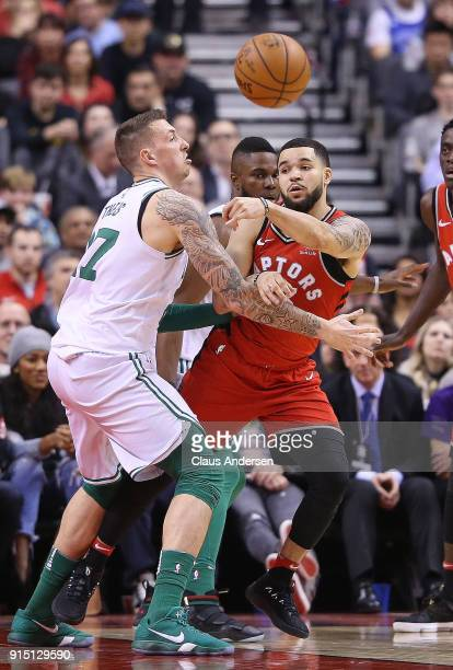 Fred VanVleet of the Toronto Raptors gets a ball past Daniel Theis of the Boston Celtics in an NBA game at the Air Canada Centre on February 6 2018...