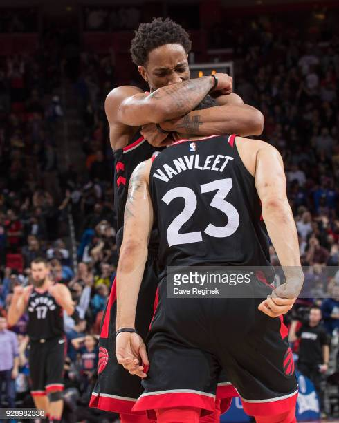Fred VanVleet of the Toronto Raptors gets a hug from teammate DeMar DeRozan after shooting the game winning bucket against the Detroit Pistons during...