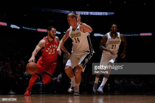 Fred VanVleet of the Toronto Raptors handles the ball against the Denver Nuggets on November 1 2017 at the Pepsi Center in Denver Colorado NOTE TO...