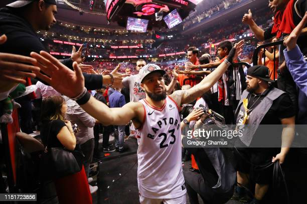 Fred VanVleet of the Toronto Raptors high fives fans as he walks off the court after defeating the Milwaukee Bucks 10094 in game six of the NBA...