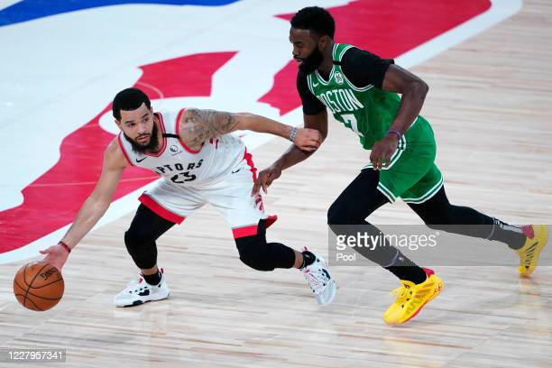 Fred VanVleet of the Toronto Raptors, left, works against Jaylen Brown of the Boston Celtics during the first half of an NBA basketball game at the...