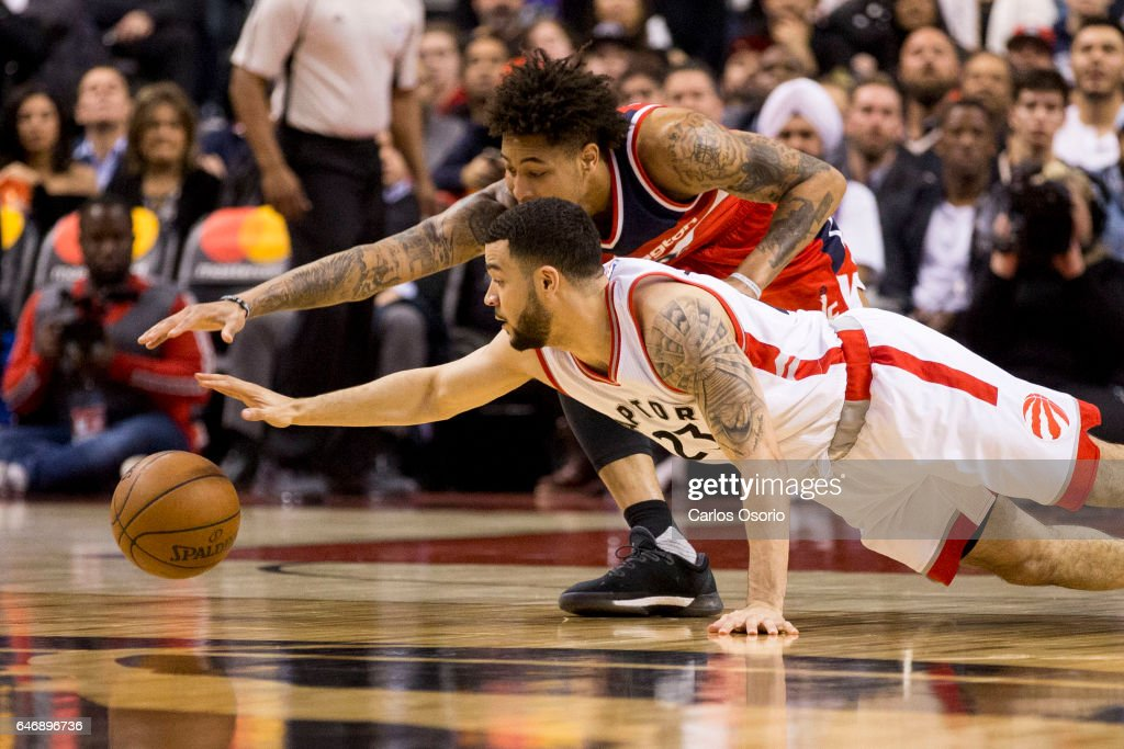 TORONTO, ON - MARCH 1 - Fred VanVleet (23) of the Toronto Raptors lunges for a loose ball against Kelly Oubre Jr. (12) of the Washington Wizards during the 1st half of NBA action as the Toronto Raptors host the Washington Wizards at the Air Canada Centre on March 1, 2017.