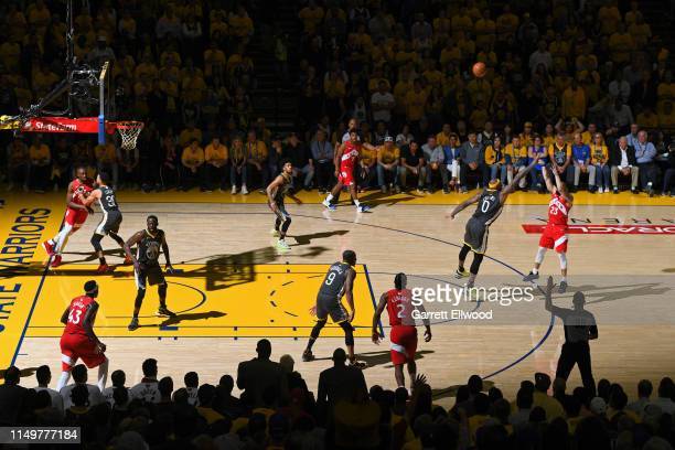 Fred VanVleet of the Toronto Raptors shoots a three point basket against the Golden State Warriors during Game Six of the NBA Finals on June 13 2019...