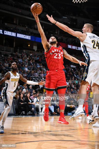 Fred VanVleet of the Toronto Raptors shoots the ball against the Denver Nuggets on November 1 2017 at the Pepsi Center in Denver Colorado NOTE TO...