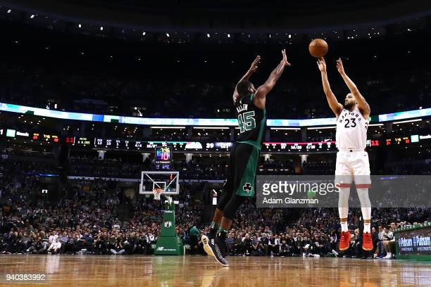 Fred VanVleet of the Toronto Raptors shoots the ball over Kadeem Allen of the Boston Celtics during a game at TD Garden on March 31 2018 in Boston...