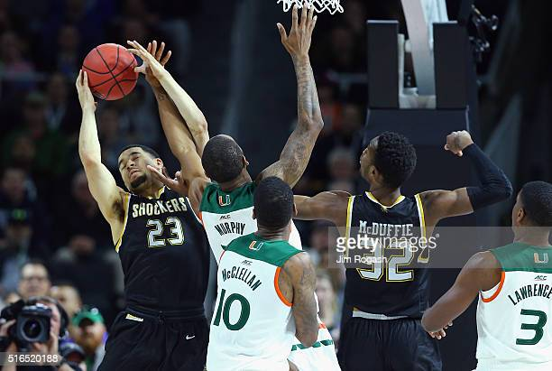 Fred VanVleet of the Wichita State Shockers and Markis McDuffie battle for the ball with Sheldon McClellan of the Miami Hurricanes and Kamari Murphy...