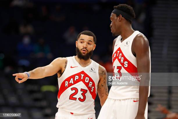 Fred VanVleet talks with Pascal Siakam of the Toronto Raptors during a preseason game against the Miami Heat on December 18, 2020 at Amalie Arena in...