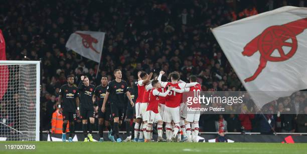 Fred, Victor Lindelof, Anthony Martial and Nemanja Matic of Manchester United react to conceding a goal tp Sokratis of Arsenal during the Premier...