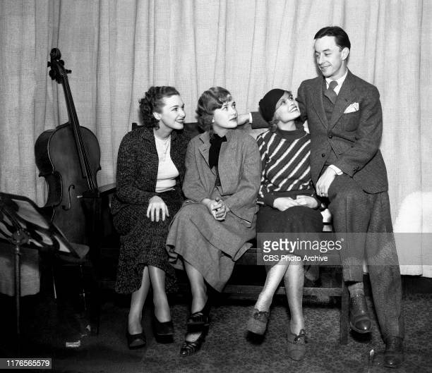 Fred Waring conductor and band leader gets ready for a CBS Radio broadcast From left is Rosemary Lane Priscilla Lane Babs Ryan and unidentified man...