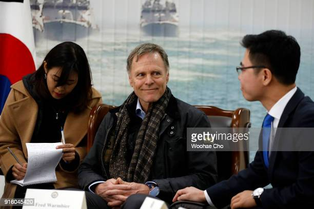 Fred Warmbier the father of Otto warmbier who was imprisoned in North Korea for 17 months smiles on Ji Seongho North Korean defector at the meeting...