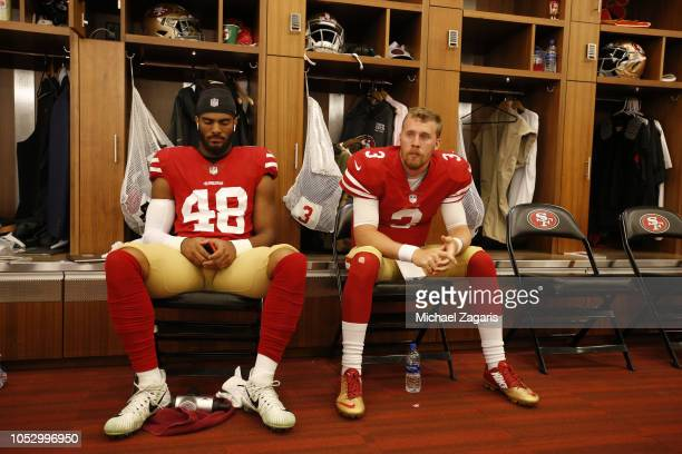 Fred Warner and CJ Beathard of the San Francisco 49ers sit in the locker room prior to the game against the Arizona Cardinals at Levi Stadium on...