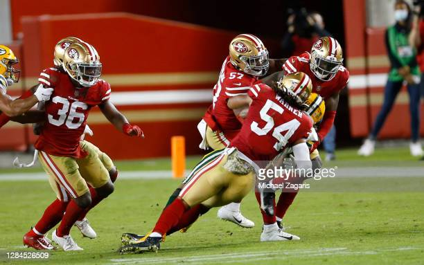Fred Warner of the San Francisco 49ers tackles Aaron Jones of the Green Bay Packers during the game at Levi's Stadium on November 3, 2020 in Santa...