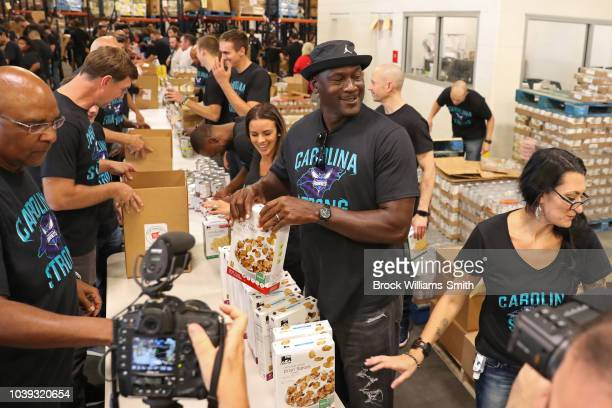 Fred Whitfield, Charlotte Hornets President, and Michael Jordan, Owner of the Charlotte Hornets, attend a food drive to help relief of Hurricane...
