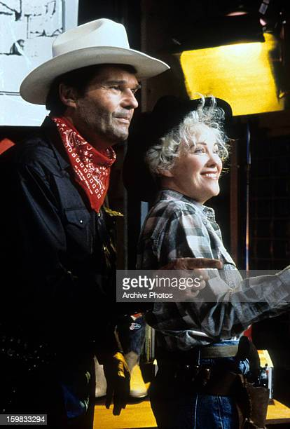 Fred Willard and Catherine O'Hara dressed as cowboys in a scene from the film 'Waiting For Guffman' 1996