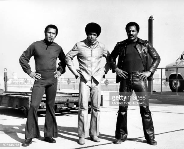 Fred Williamson Jim Kelly and Jim Brown pose for the movieThree the Hard Way circa 1974