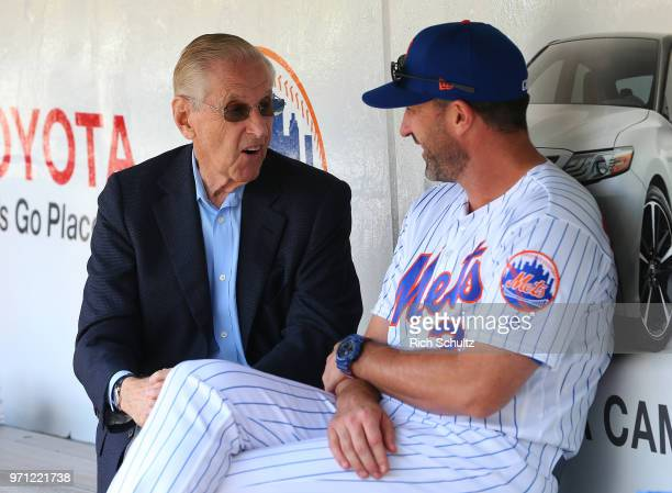 Fred Wilson owner of the New York Mets talks with manager Mickey Callaway before a game against the Baltimore Orioles at Citi Field on June 6 2018 in...