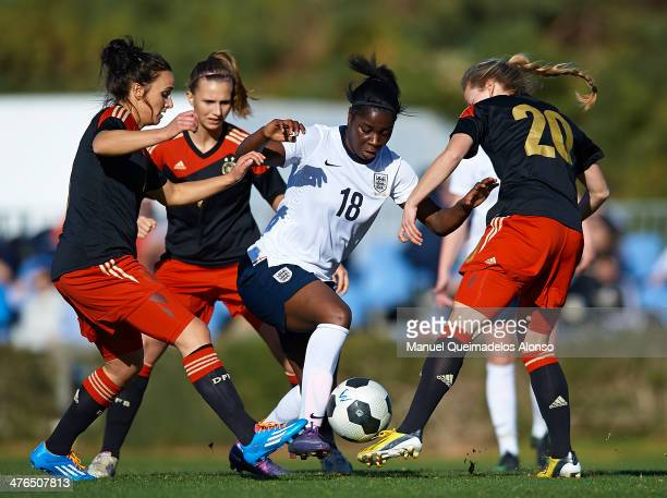 Freda Aiysi of England competes for the ball with Margarita Gidion and Lina Magull of Germany during the U23 friendly match between England and...