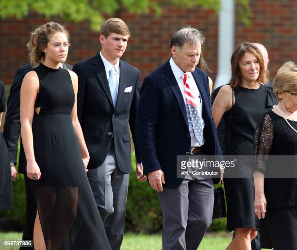 Fredand Cindy Warmbieralong with other members of the Warmbier family are seen leaving Wyoming High Schoolin Wyoming Ohio on June 22 following the...