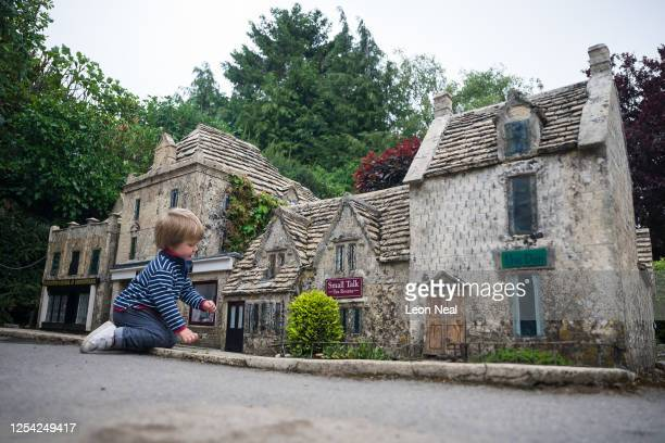 Freddie aged 2 from Beaconsfield knocks on the door of one of the miniature buidlings of the model village on July 04 2020 in BourtonontheWater...