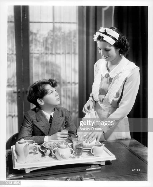 Freddie Bartholomew being served by maid in a scene from the film 'Captains Courageous' 1937