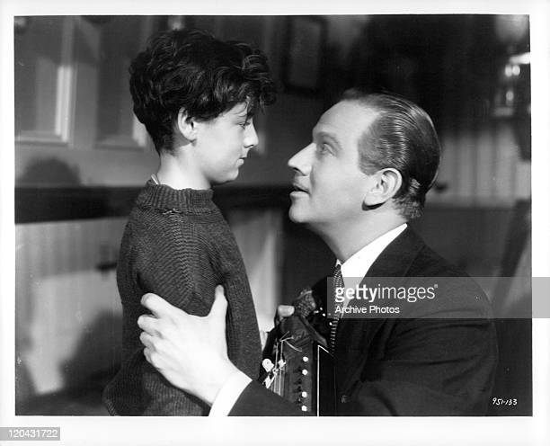 Freddie Bartholomew is held by Melvyn Douglas in a scene from the film 'Captains Courageous' 1937