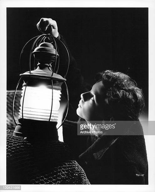 Freddie Bartholomew with lantern in a scene from the film 'Captains Courageous' 1937