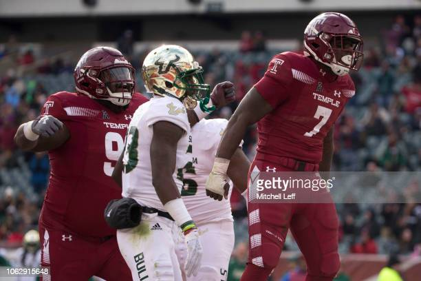 Freddie BoothLloyd and Ryquell Armstead of the Temple Owls celebrate in front of Mazzi Wilkins of the South Florida Bulls after a touchdown by...