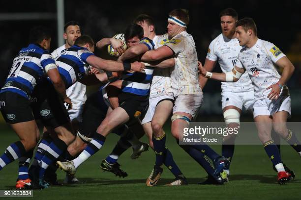 Freddie Burns of Bath is lifted off his feet by GJ Van Velze of Worcester during the Aviva Premiership match between Worcester Warriors and Bath...