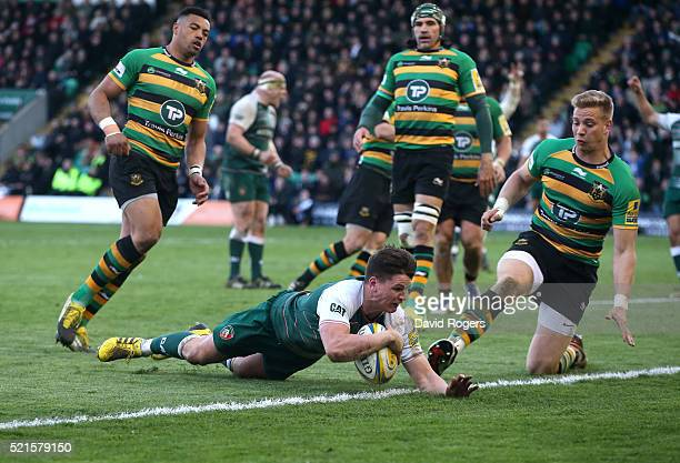 Freddie Burns of Leicester dives over for a try during the Aviva Premiership match between Northampton Saints and Leicester Tigers at Franklin's...