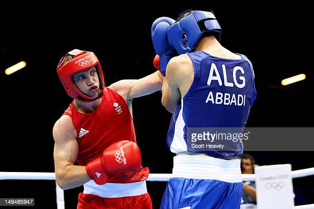 Freddie Evans of Great Britain in action with Ilyas Abbadi of Algeria during their Men's Welter Boxing bout on day 2 of the London 2012 Olympic Games...