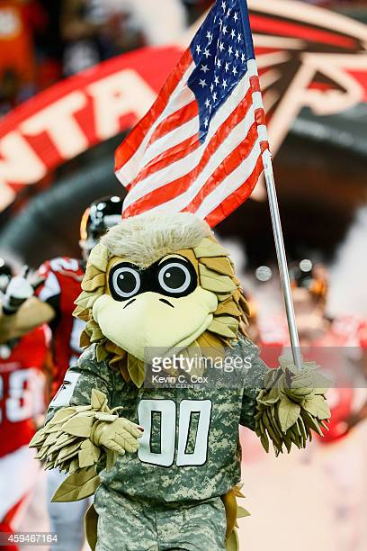Freddie Falcon runs out on the field in a military uniform to honor the troops prior to the game against the Cleveland Browns at Georgia Dome on...