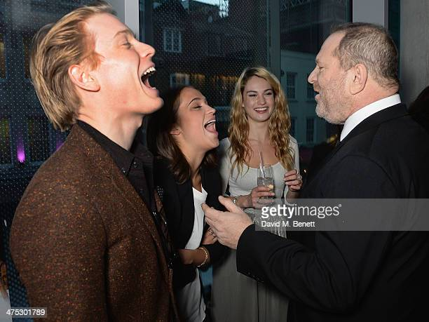 Freddie Fox Alicia Vikander Lily James and Harvey Weinstein attend a VIP screening of Harvey Weinstein's Escape From Planet Earth at The W Hotel on...