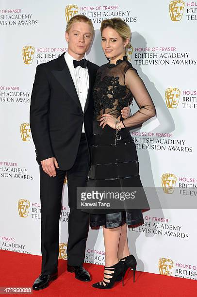 Freddie Fox and Dianna Agron pose in the winners room at the House of Fraser British Academy Television Awards at Theatre Royal on May 10, 2015 in...