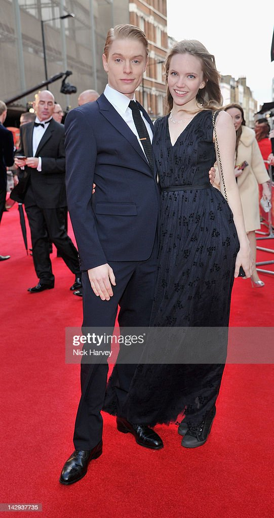 Freddie Fox and Tamzin Merchant arrive at the Olivier Awards 2012 at The Royal Opera House on April 15, 2012 in London, England.