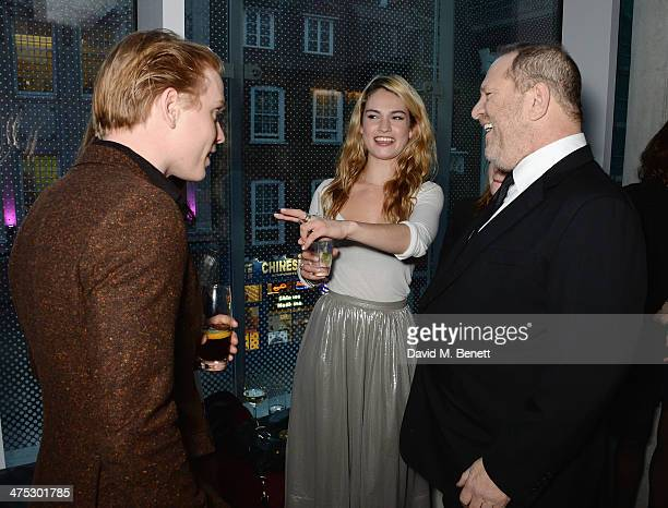 Freddie Fox Lily James and Harvey Weinstein attend a VIP screening of Harvey Weinstein's Escape From Planet Earth at The W Hotel on February 27 2014...